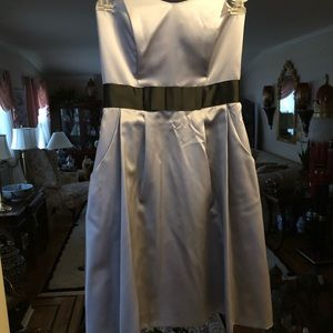 Tea length gray satin dress with black belt
